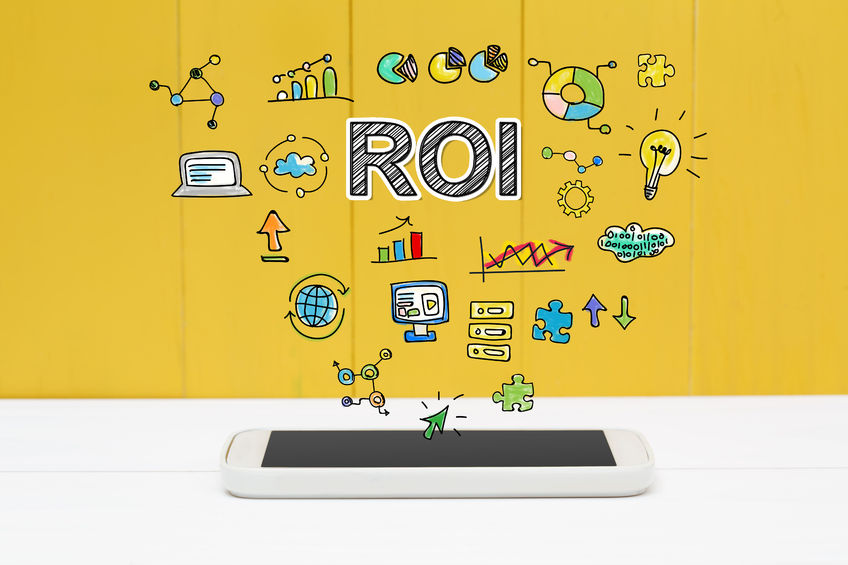 53676707 – roi concept with smartphone on yellow wooden background