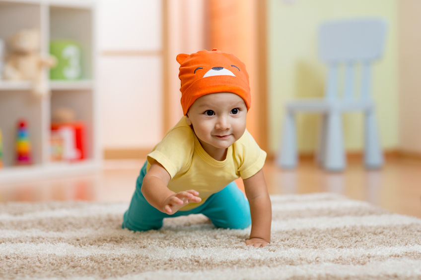 47430319 – baby boy at home crawling on carpet