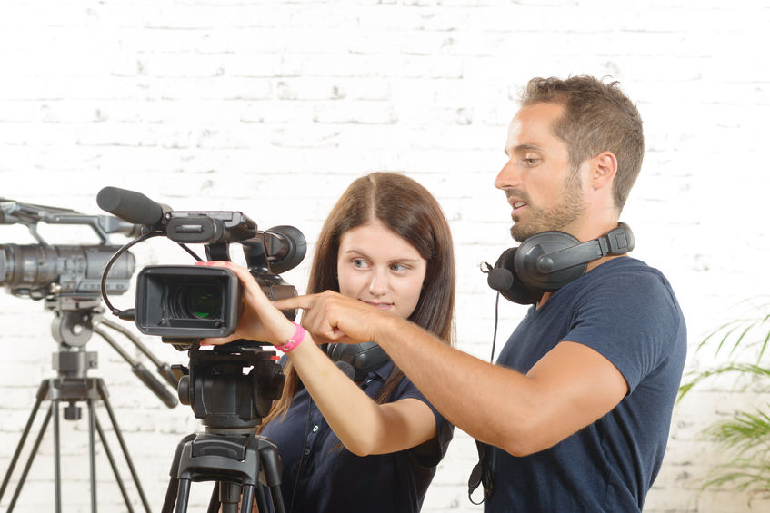 45555122 – a cameraman and a young woman with a movie camera