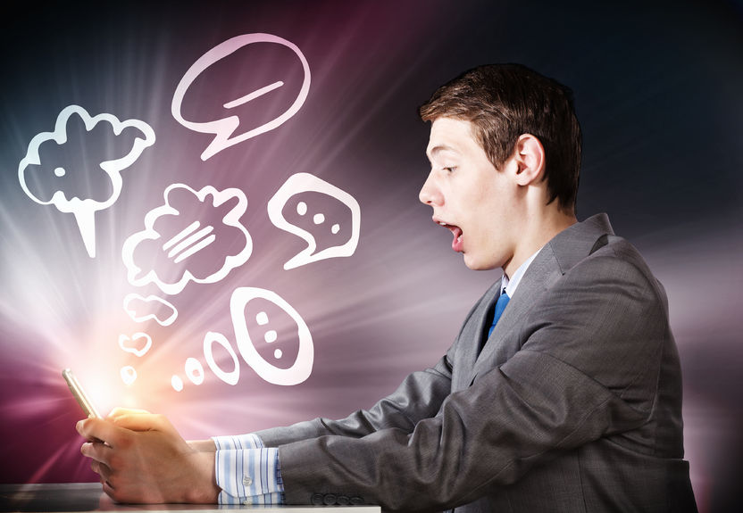38194402 – young emotional businessman looking shocked in tablet pc