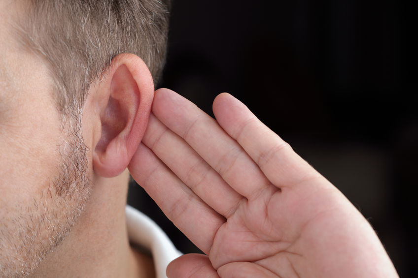 25087910 – man with hand on ear listening for quiet sound or paying attention