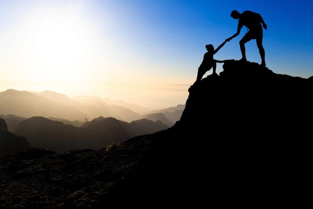 Men Helping Women To Climb