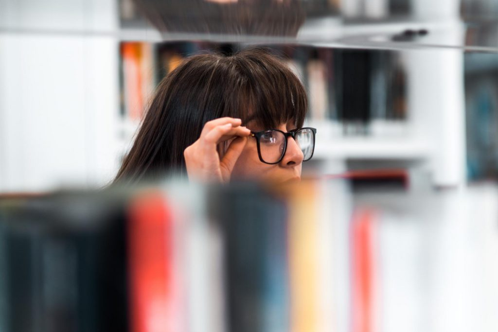 Woman wearing glasses doing research